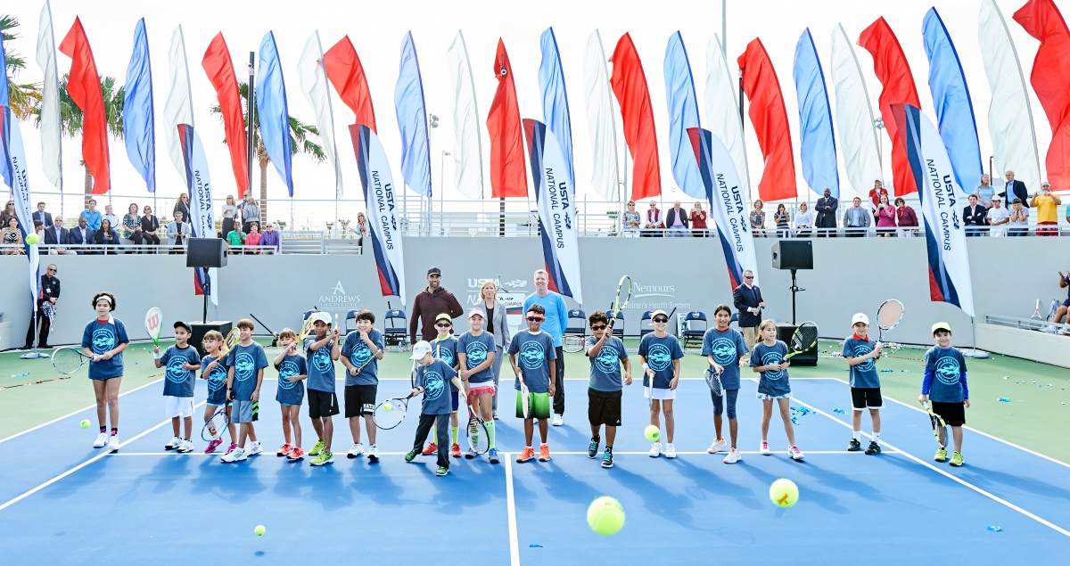 """January 5, 2017 - James Blake, USTA Foundation Chairman of the Board, tennis legend Chris Evert and US Davis Cup Captain Jim Courier, USTA Chairman of the Board with local tennis playersduring """"First Serve"""" at the USTA National Campus at Lake Nona in Orlando, Florida"""